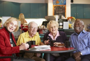 Senior adults having morning tea together